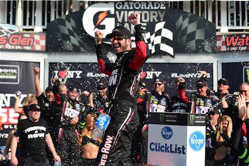 Martin Truex Jr. celebrates in victory lane at Watkins Glen International after winning the I Love New York 355 at The Glen on Aug. 6, 2017 (photo courtesy of Getty Images for NASCAR).