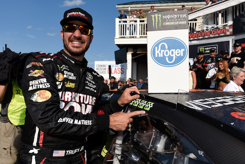 Martin Truex Jr. celebrates his fourth Monster Energy NASCAR Cup Series win of 2017 at Watkins Glen International on Aug. 6, 2017 (photo courtesy of Getty Images for NASCAR).