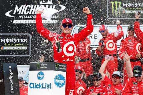 Kyle Larson celebrates in victory lane at Michigan International Speedway after winning the Pure Michigan 400 on Aug. 13, 2017 (photo courtesy of Getty Images for NASCAR).