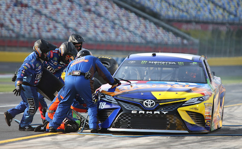 No. 18 Joe Gibbs Racing team of Kyle Busch on pit road (photo courtesy of Getty Images for NASCAR)