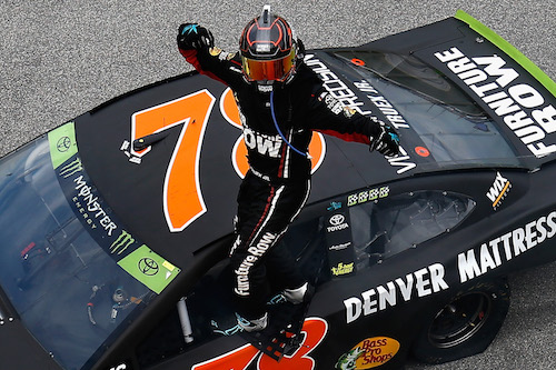 Martin Truex Jr. celebrates his win of the Nickelodeon Tales of the Turtles 400 at Chicagoland Speedway on Sept. 17, 2017 (photo courtesy of Getty Images for NASCAR).
