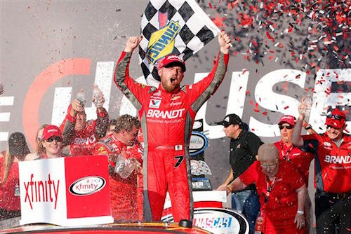 Justin Allgaier celebrates in victory lane at Chicagoland Speedway after winning TheHouse.com 300 on Sept. 16, 2017 (photo courtesy of Getty Images for NASCAR).
