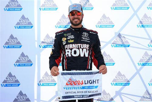 Martin Truex Jr. celebrates winning the pole for the Apache Warrior 400 at Dover International Speedway on Sept. 29, 2017 (photo courtesy of Getty Images for NASCAR).
