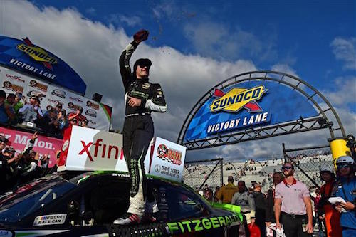 Ryan Blaney celebrates in victory lane at Dover International Speedway after winning the Use Your Melon Drive Sober 200 on Sept. 30, 2017 (photo courtesy of Getty Images for NASCAR).