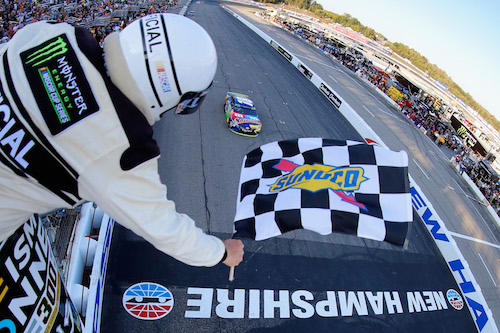 Kyle Busch takes the checkered flag to win the ISM Connect 300 at New Hampshire Motor Speedway on Sept. 24, 2017 (photo courtesy of Getty Images for NASCAR).