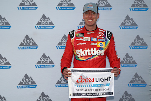 Kyle Busch celebrates his seventh pole of 2017 Monster Energy NASCAR Cup Series season on Sept. 15, 2017, at Chicagoland Speedway