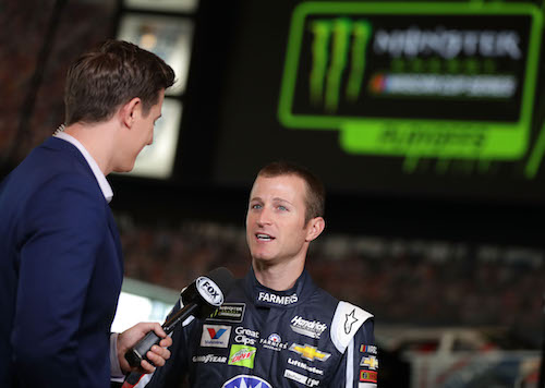Kasey Kahne speaks to a reporter during NASCAR playoffs media day on Sept. 13, 2017 (photo courtesy of Getty Images for NASCAR).