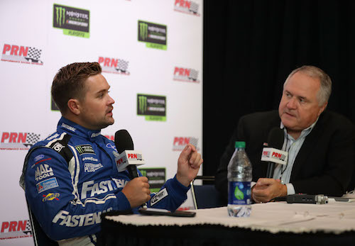 Ricky Stenhouse Jr. (left) is interviewed during the NASCAR playoffs media day Sept. 13, 2017 (photo courtesy of Getty Images for NASCAR).