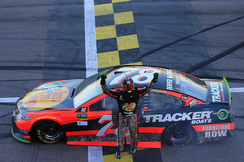 Martin Truex Jr. celebrates his win of the Hollywood Casino 400 at Kansas Speedway on Oct. 22, 2017 (photo courtesy of Getty Images for NASCAR).