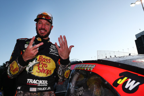 Martin Truex Jr. celebrates his seventh win of 2017 at Kansas Speedway on Oct. 22, 2017 (photo courtesy of Getty Images for NASCAR).