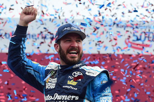 Martin Truex Jr. celebrates in victory lane after winning the Bank of America 500 at Charlotte Motor Speedway on Oct. 8, 2017 (photo courtesy of Getty Images for NASCAR).