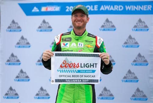 Dale Earnhardt Jr. celebrates winning the pole for the Alabama 500 at Talladega Superspeedway on Oct. w14, 2017 (photo courtesy of Getty Images for NASCAR).