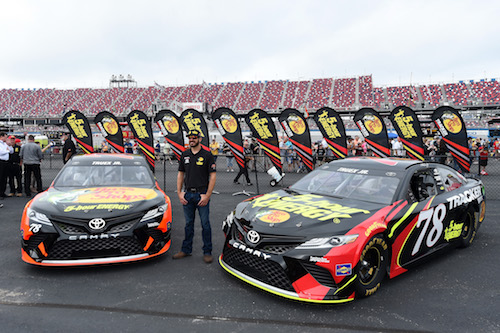 Martin Truex Jr. with two of his No. 78 Toyota for 2018 at Talladega Superspeedway on Oct. 15, 2017 (photo courtesy of Getty Images for NASCAR).