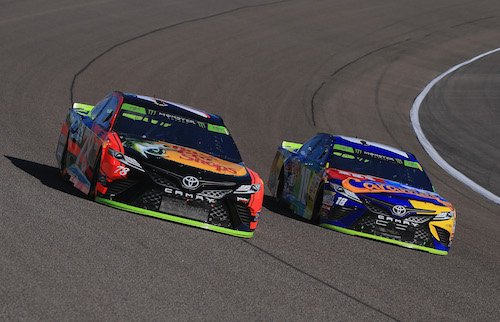 Martin Truex Jr. (78) and Kyle Busch (18) race for position during the Ford EcoBoost 400 at Homestead-Miami Speedway on Nov. 19, 2017 (photo courtesy of Getty Images for NASCAR).