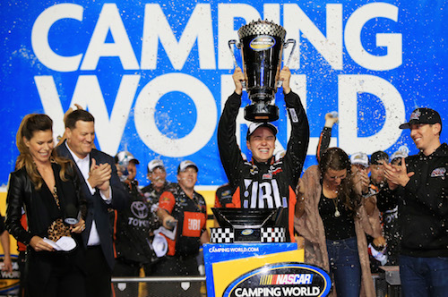 Christopher Bell hoists the 2017 NASCAR Camping World Truck Series champion's trophy at Homestead-Miami Speedway on Nov. 17, 2017 (photo courtesy of Getty Images for NASCAR).
