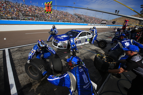 The No. 88 Hendrick Motorsports Chevrolet team of Dale Earnhardt Jr. performs a pit stop during the Can-Am 500 at Phoenix International Raceway on Nov. 12, 2017 (photo courtesy of Getty Images for NASCAR).
