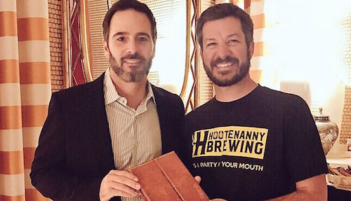 Jimmie Johnson (left) presents 2017 Monster Energy NASCAR Cup Series champion Martin Truex Jr. with the champion's journal during Champion's Week in Las Vegas (photo courtesy of Jimmie Johnson via Instagram).