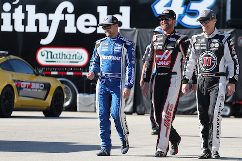 Stewart-Haas Racing drivers Kurt Busch and Kevin Harvick (center and right) with Ricky Stenhouse Jr. at Homestead-Miami Speedway in November 2017 (photo courtesy of Getty Images for NASCAR)