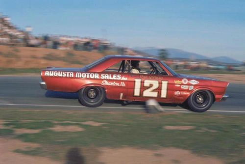 Dan Gurney behind the wheel for one of his races with Wood Brothers Racing at Riverside International Raceway (photo courtesy of ISC Archives/Getty Images)