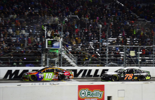 Kyle Busch (18) and Martin Truex Jr. (78) race at Martinsville Speedway on Oct. 29, 2017 (photo courtesy of Getty Images for NASCAR).