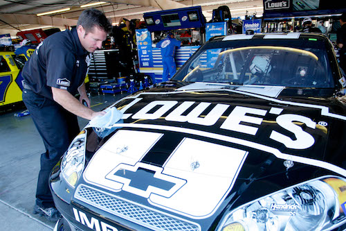 Ron Malec with the No. 48 Hendrick Motorsports Chevrolet in the garage at Phoenix International Raceway in 2012 (photo courtesy of Getty Images for NASCAR).