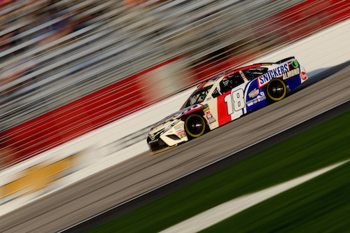 Kyle Busch makes a pole-winning run at Atlanta Motor Speedway on Feb. 23, 2018 (photo courtesy of Getty Images for NASCAR).