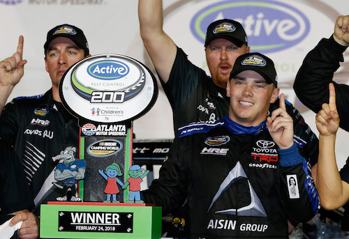 Brett Moffitt and his Hattori Racing Enterprises team celebrate in victory lane after winning the Active Pest Control 200 at Atlanta Motor Speedway on Feb. 24, 2018 (photo courtesy of Getty Images for NASCAR).
