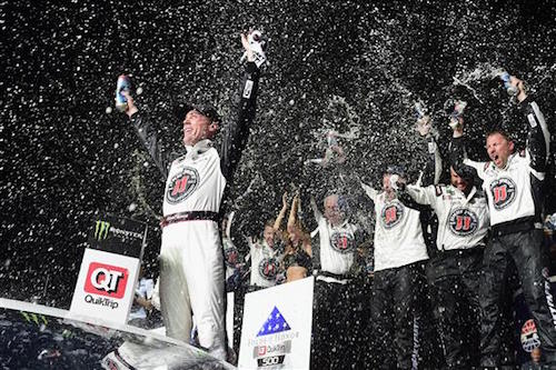 Kevin Harvick celebrates in victory lane at Atlanta Motor Speedway after winning the Folds of Honor QuikTrip 500 on Feb. 25, 2018 (photo courtesy of Getty Images for NASCAR).