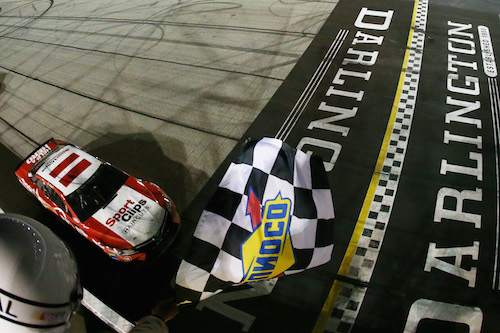 Denny Hamlin takes the checkered flag in the Southern 500 at Darlington Raceway on Sept. 3, 2017 (photo courtesy of Getty Images for NASCAR).