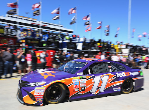 Denny Hamlin drives his No. 11 Joe Gibbs Racing Toyota through the garage area at Martinsville Speedway on April 1, 2017 (photo courtesy of Getty Images for NASCAR).